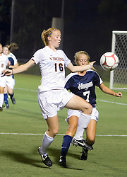 Virginia Cavaliers forward Maggie Kistner (16) takes possession from Georgetown Hoyas defender Gabby Miller (7).  The #6 Virginia Cavaliers played the Georgetown Hoyas to a 2-2 draw in a NCAA Women's Soccer pre-season exhibition game held at Klockner Stadium on the Grounds of the University of Virginia in Charlottesville, VA on August 18, 2008.