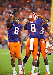 November 21, 2009; Clemson, SC, USA; Clemson Tigers wide receiver Jacoby Ford (6) and running back Jamie Harper (8) and running back C.J. Spiller (28) celebrate after the game against the Virginia Cavaliers at Memorial Stadium.  Clemson defeated Virginia 34-21.