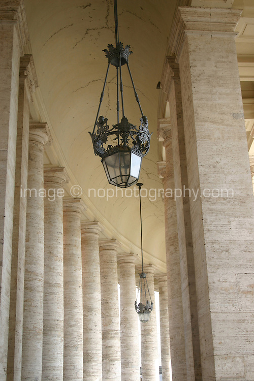 Lamp in the archway around St Peters square, the Vatican, Rome, Italy<br />