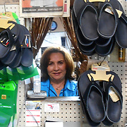 Magalis Feria, owner of Tommy's Shoe Repair in North Miami in the back of the shop where the repairs work is done. Tommy's Shoe Repair Shop has been in business since 1977 and originated in New York. (Photo by Edeline Mezinord)