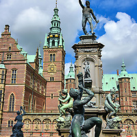 Neptune Fountain at Frederiksborg Castle in Hiller&oslash;d, Denmark   <br /> This fountain in the inner courtyard of the Frederiksborg Castle was created in 1620 to demonstrate King Christian IV&rsquo;s command of the waters of Denmark and Norway. The bronze figure on top is Neptune, the Roman god of the sea. In the pedestal niches are deities of rivers, springs and water. They are surrounded by naiads who are water nymphs from Greek mythology.  Along the marble basin are mermen shown blowing twisted conch shells. They are tritons, the messengers of the sea.