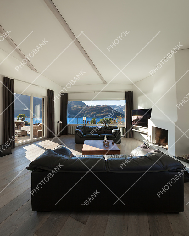 Interior of house, comfortable living room with wide window