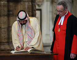 The President of the United Arab Emirates, Sheikh Khalifa bin Zayed Al Nahyan signs the Distinguished Visitors' Book at Westminster Abbey in London watched by Very Rev Dr.John Hall, Dean of Westminster, on the second day of his state visit to the UK, Wednesday ,1st May 2013 Photo by: Stephen Lock / i-Images