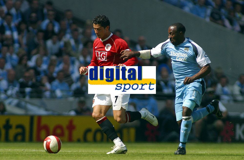Photo: Paul Thomas.<br /> Manchester City v Manchester United. The Barclays Premiership. 05/05/2007.<br /> <br /> Darius Vassell (R) of City tries to catch Cristiano Ronaldo.
