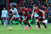Mbwana Samatta (20) of Aston Villa on the attack chased by Jefferson Lerma (8) of AFC Bournemouth and Simon Francis (2) of AFC Bournemouth during the Premier League match between Bournemouth and Aston Villa at the Vitality Stadium, Bournemouth, England on 1 February 2020.