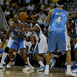 27 April 2009: Denver Nuggets guard Chauncey Billups (7) passes to forward Kenyon Martin (4) as New Orleans Hornets guard Chris Paul (3) defends during game four of the NBA Western Conference Quarterfinals playoffs between the New Orleans Hornets and the Denver Nuggets at the New Orleans Arena in New Orleans, Louisiana.