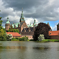 National History Museum at Frederiksborg Castle in Hiller&oslash;d, Denmark <br /> Welcome to Frederiksborg Castle!  Most of this stunning, quadrangular-shaped palace was constructed during the early 17th century on three islets in the town of Hiller&oslash;d.  It is the finest and largest example of Renaissance architecture in Scandinavia and is frequently called the Nordic Versailles.  Since being reconstructed in the late 19th century, it is home to the Museum of National History. Inside you will find an extensive collection of portraits of royalty, soldiers, politicians and the cultural elite that span centuries. Also on display are ornate rooms with period furnishings, tapestries and artifacts. The museum and the restoration were funded by the Carlsberg Foundation. It was established by J. C. Jacobsen, the founder of the Carlsberg brewery.