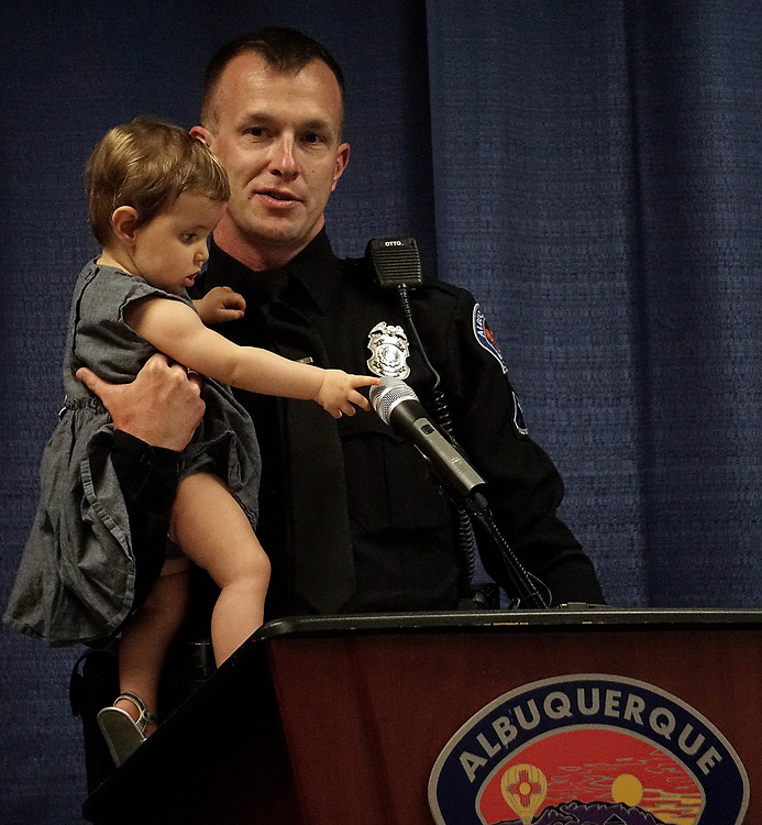 apl061217a/ASECTION /pierre-louis/JOURNAL 061217<br /> 8 months-old Liliana Haugh,, reaches for the microphone after her father, APD Officer Paul Haugh,, received the Bill Daniels True Blue Award at a ceremony held at the APD Training Academy. Officer Haugh was recognized after he used his own money  to purchase bicycles for two youngsters who had theirs stolen on their way home from the swimming pool .Photographed  on Monday June  12,  2017. .Adolphe Pierre-Louis/JOURNAL