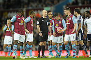 Referee Anthony Taylor in discussion with Ciaran Clark of Aston Villa before a Villa free-kick is taken. The FA cup, 6th round match, Aston Villa v West Bromwich Albion at Villa Park in Birmingham, Midlands on Saturday 7th March 2015<br /> pic by John Patrick Fletcher, Andrew Orchard sports photography.