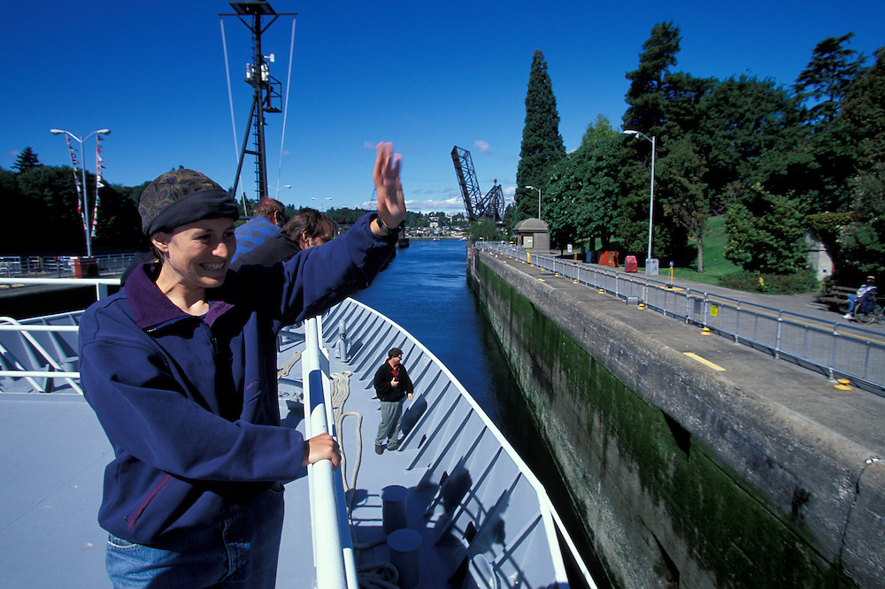USA, Washington, Seattle, UW Oceanography grad student waves from R/V Thomas G. Thompson leaving port