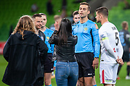 Officials and team captains Melbourne City defender Scott Jamieson (3) and Western Sydney Wanderers defender Brendan Hamill (5) flip the coin at the FFA Cup quarter-final soccer match between Melbourne City FC and Western Sydney Wanderers FC at AAMI Park in Melbourne.