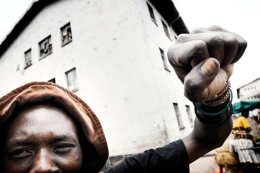 USE ARROWS ← → on your keyboard to navigate this slide-show<br /> <br /> Harare, Zimbabwe 17 November 2007<br /> An unidentified man gestures to the photographer in Nyerere Flats, poor neighbourhood in the south of Harare.<br /> Photo: Ezequiel Scagnetti