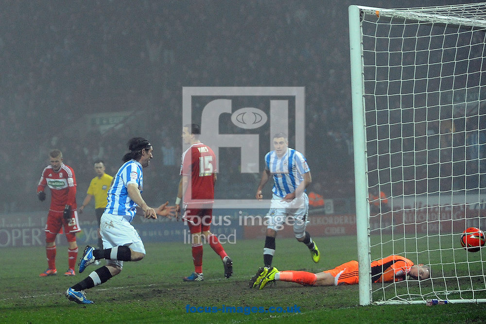 Picture by Graham Crowther/Focus Images Ltd +44 7763 140036.05/03/2013.Alan Lee of Huddersfield Townscores the equaliser against Middlesbrough during the npower Championship match at the John Smiths Stadium, Huddersfield.