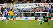 Hartlepool - Saturday August 29th, 2009: Stephen Hughes of Norwich City puts the ball past Hartlepool goalkeeper Scott Flinders to score the second goal during the Coca Cola League One match at Victoria Park, Hartlepool. (Pic by Jed Wee/Focus Images)..