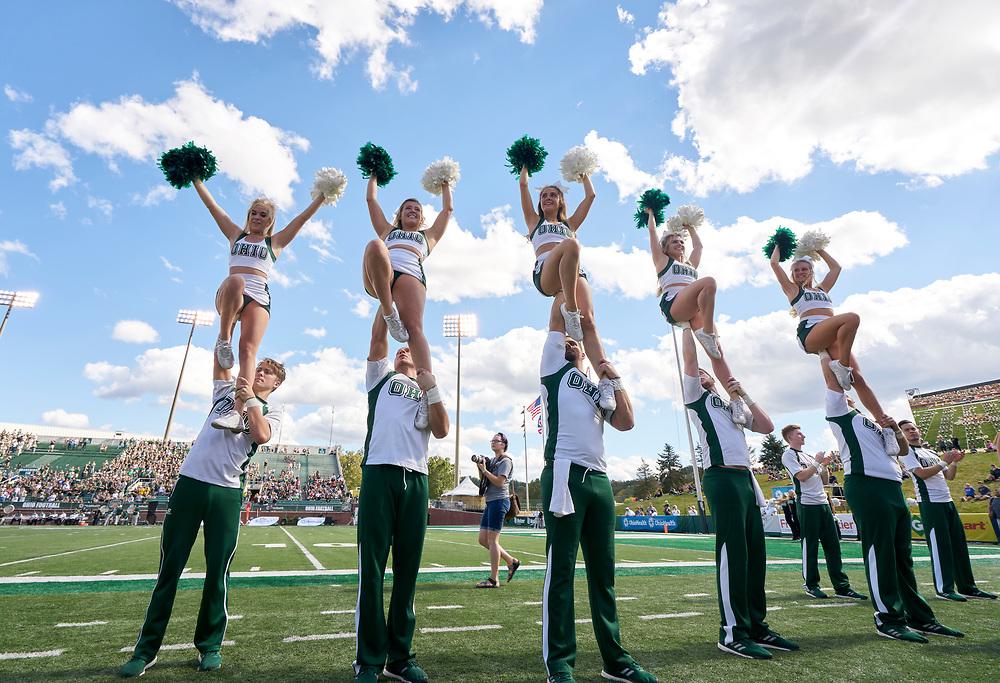 Ohio University Cheerleaders rile up the crowd.