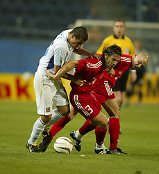 TEPLICE, CZECH REPUBLIC - Wednesday, April 30, 2003: Czech Republic's Milan Baros battles with two Turkey players during a friendly match at the Teplice Stadion Na Stinadlech. (Pic by David Rawcliffe/Propaganda)