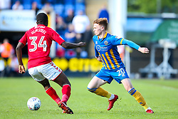 Jon Nolan of Shrewsbury Town takes on Anfernee Dijksteel of Charlton Athletic - Mandatory by-line: Robbie Stephenson/JMP - 13/05/2018 - FOOTBALL - Montgomery Waters Meadow - Shrewsbury, England - Shrewsbury Town v Charlton Athletic - Sky Bet League One Play-Off Semi Final