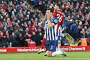 Brighton and Hove Albion defender Lewis Dunk (5) misses a chance right in front of goal  during the Premier League match between Liverpool and Brighton and Hove Albion at Anfield, Liverpool, England on 30 November 2019.