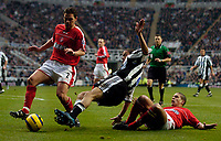 Fotball<br /> England 2004/2005<br /> Foto: SBI/Digitalsport<br /> NORWAY ONLY<br /> <br /> Newcastle United v Charlton Athletic, Barclays Premiership, 05/02/2005.<br /> <br /> Newcastle's Kieron Dyer goes down in the box following a tackle by Charlton's Chris Perry as Newcastle become increasingly desperate in the closing stages of the game, with referee Mark Halsey looking on.