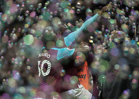 Football - 2017 / 2018 Premier League - West Ham United Vs Huddersfield Town<br /> <br /> Pedro Obiang (West Ham United)  and Michail Antonio (West Ham United)  celebrate amongst the bubbles at the London Stadium<br /> <br /> COLORSPORT/DANIEL BEARHAM