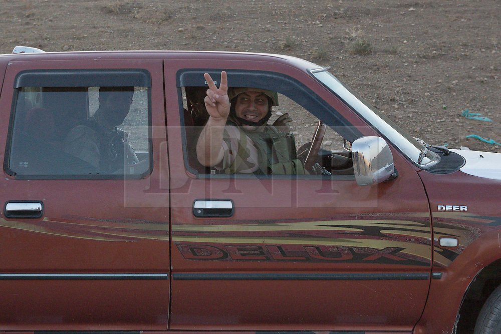 20/10/2016. Bashiqa, Iraq. A Kurdish peshmerga fighter flashes a V for victory sign as he and his colleagues drive forward to take start part of an offensive to retake Mosul from Islamic State militants today (20/10/2016).<br />