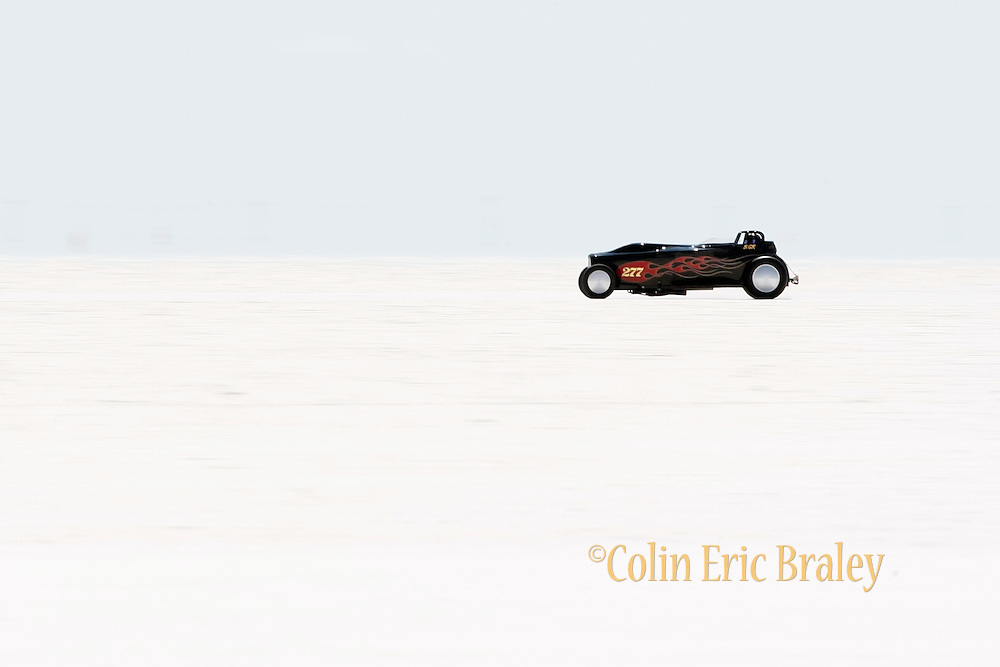 The best cars-people-atmosphere-photos of 2009 Bonneville Speed Week-  The Barbee Boys Racing Roadster from Dana Point, CA rolls down the long track at the Bonneville Speed Way. August 9, 2009.  Photos by Colin E. Braley