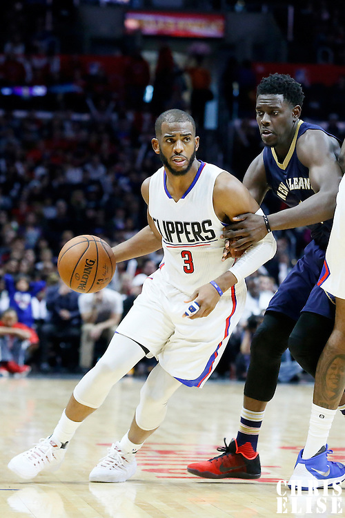 10 January 2016: Los Angeles Clippers guard Chris Paul (3) drives past New Orleans Pelicans guard Jrue Holiday (11) during the Los Angeles Clippers 114-111 overtime victory over the New Orleans Pelicans, at the Staples Center, Los Angeles, California, USA.