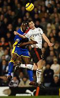 Photo: Daniel Hambury.<br />Fulham v Tottenham Hotspurs. Barclays Premiership. 31/01/2006.<br />Fulham's Heidar Helguson and Tottenham's Ledley King battle.