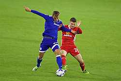 CARDIFF, WALES - Wednesday, August 17, 2016: Cardiff City's Emyr Huws in action against Blackburn Rovers' Darragh Lenihan during the Football League Championship match at Cardiff City Stadium. (Pic by David Rawcliffe/Propaganda)