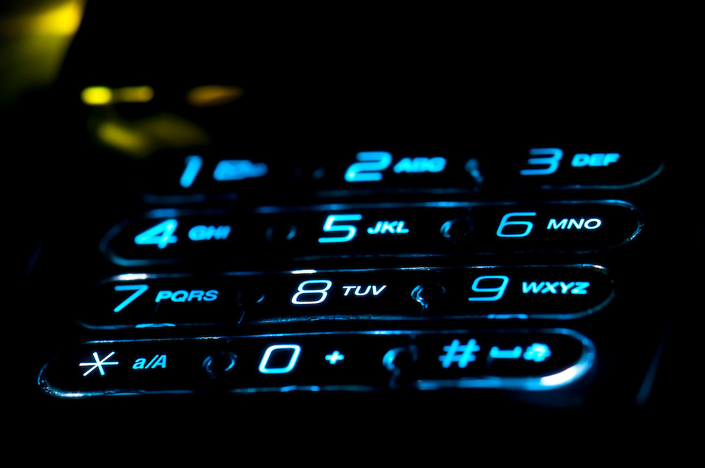 Close up view of a cell phone keypad ringing. Use of selective focus.