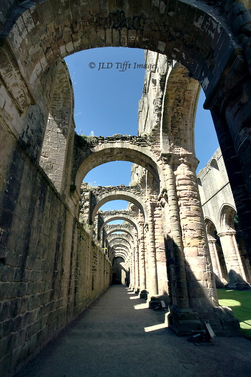 Yorkshire, Fountains Abbey ruins; looking along the south aisle.