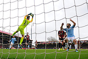 Artur Boruc (1) of AFC Bournemouth grabs to the ball as Sergio Aguero (10) of Manchester City waits for any mistakes during the Premier League match between Bournemouth and Manchester City at the Vitality Stadium, Bournemouth, England on 2 March 2019.