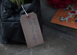© Licensed to London News Pictures. 26/12/2016. Goring-, UK. A card attached to a floral tribute reads ' Rest in Peace with the angels' - left at the door of George Michael's Oxfordshire home. Pop superstar George Michael died on Christmas day at his Oxfordshire home on the River Thames aged 53. Photo credit: Peter Macdiarmid/LNP