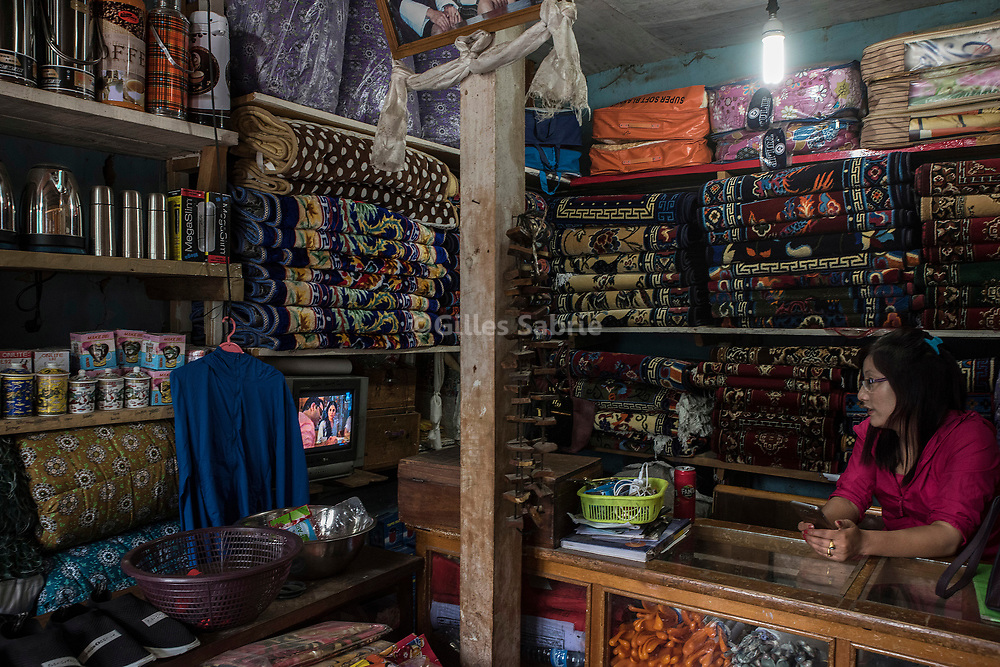 For a story by Steven Lee Myers, Bhutan<br /> Haa, Bhutan, August 3rd, 2017<br /> In Haa, a shop owner selling Chinese goods smuggled over the nearby border between Bhutan and China, watching an Indian soap on TV. The informal import of Chinese products is a source of income for locals who go on a 1 day trek to the nearest Tibetan town to buy goods and bring them back on horseback. China has shut down traffic between the two countries since the border dispute escalated last month, leading to showdown between India and China. <br /> Gilles Sabri&eacute; pour The New York Times
