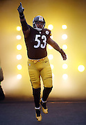 Pittsburgh Steelers center Maurkice Pouncey (53) points as he comes onto the field for the NFL week 16 regular season football game against the Kansas City Chiefs on Sunday, Dec. 21, 2014 in Pittsburgh. The Steelers won the game 20-12 and clinched an AFC playoff spot. ©Paul Anthony Spinelli