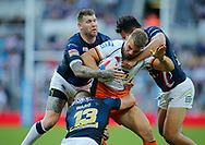 Mike McMeeken (C) of Castleford Tigers tackled by Brett Delaney (L) and Nathaniel Peteru (R) and Stevie Ward of Leeds Rhinos during the Betfred Super League match at the Dacia Magic Weekend, St. James's Park, Newcastle<br /> Picture by Stephen Gaunt/Focus Images Ltd +447904 833202<br /> 19/05/2018