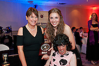 Ability West CEO Breda Crehan-Roche presents  Overall Best Buddies Match winners, Amy Rossiter, Wexford and Emma Moran, Menlo at the Ability West, Best Buddies ball at the Menlo Park Hotel, Galway. Photo:Andrew Downes Photography.
