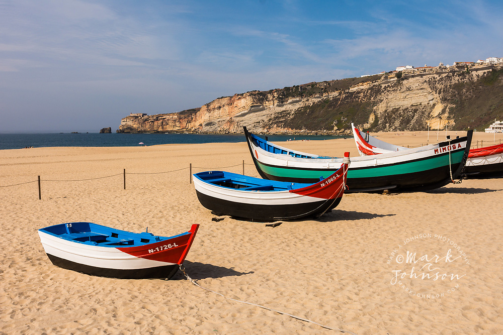 Old restored lifeboats on the beach, Nazare, Portugal