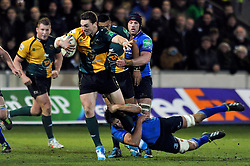George North(Northampton) takes on the Leinster defence - Photo mandatory by-line: Patrick Khachfe/JMP - Tel: Mobile: 07966 386802 07/12/2013 - SPORT - RUGBY UNION -  Franklin's Gardens, Northampton - Northampton Saints v Leinster - Heineken Cup.