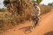 ICS volunteer Dan Hensman cycling to his morning session, in the village of in Banteay Char, near Battambang, Cambodia.