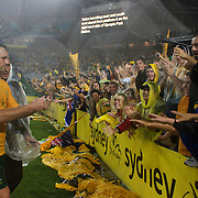 Australian captain Lucas Neill  celebrates with fans after the match during the 2010 Fifa World Cup Asian Qualifying match between Australia and Uzbekistan at Stadium Australia in Sydney, Australia on April 01, 2009. Australia won the match 2-0.  Photo Tim Clayton
