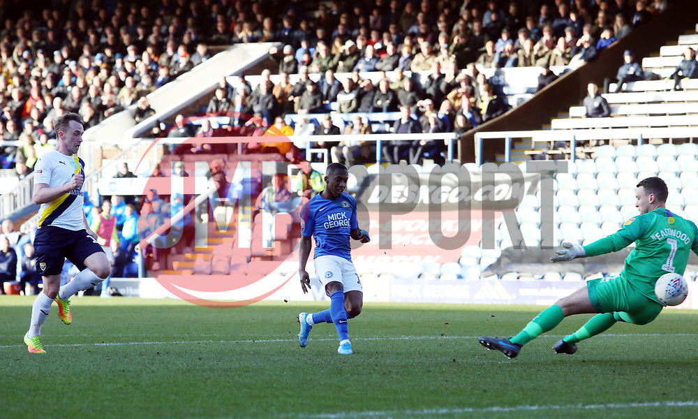 Siriki Dembele of Peterborough United scores the opening goal of the game past Simon Eastwood of Oxford United - Mandatory by-line: Joe Dent/JMP - 08/02/2020 - FOOTBALL - Weston Homes Stadium - Peterborough, England - Peterborough United v Oxford United - Sky Bet League One
