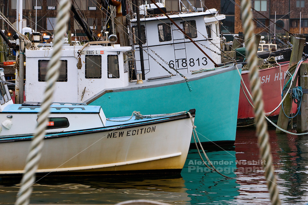 USA, Newport, RI -  Fishing and lobster boats tied up at the state fishing pier.