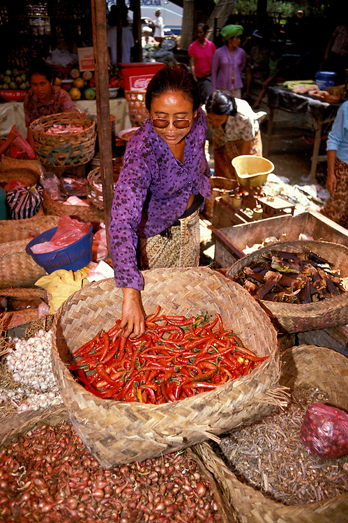Market at Ubud, Bali, Indonesia, Asia, Bali, Indonesia, Asia, photo bali220, Photo Copyright:  Lee Foster, www.fostertravel.com, 510-549-2202, lee@fostertravel.com,  food, vegetables, market, shopper, peppers, people, vertical