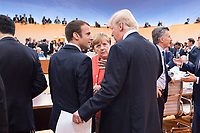 07 JUL 2017, HAMBURG/GERMANY:<br /> Emmanuel Macron (L), Praesident Frankreich, Angela Merkel (M), CDU, Bundeskanzlerin, und Donald Trump (R), Praesident Vereinigte Staatsn von America, USA, im Gesprech, vor Beginn der 1. Arbeitssitzung, G20 Gipfel, Messe<br /> IMAGE: 20170707-01-041<br /> KEYWORDS: G20 Summit, Deutschland, Gespr&auml;ch