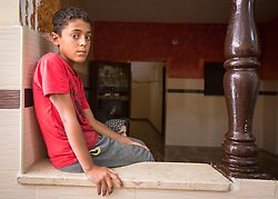 © Licensed to London News Pictures. 17/07/2014. Gaza.   <br /> The cousin of Ismail Bakir, Mansur Bakir, one of the four boys killed in an Israeli air strike on a beach in Gaza sits in his house and received condolences from surrounding families.  Photo credit: Alison Baskerville/LNP