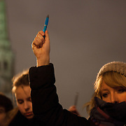A woman holds up a pen in  defiance against the attack on freedom of speech. Londoners show their solidarity with the 12 people killed in an attack on the magazine Charlie Hebdo in Paris and their revulsion of the attack on freedom of speech at a vigil in Trafalgar Square. Three attackers killed ten journalist working for Charlie Hebdo and two police officers, the worst terrorist attack in Paris, France in 50 years.
