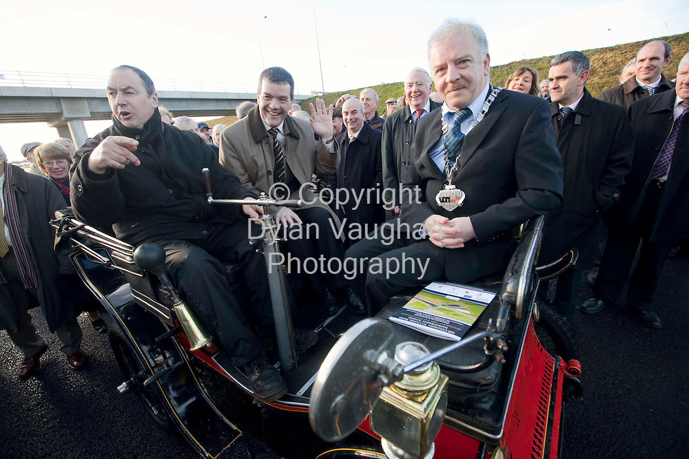 8/12/2008.Pictured at the opening of the new EUR435 million  Cullahill to Cashel Road at Urlingford yesterday was Noel Demsey TD, Minister for Transport with Cllr Thomas Breathnach, Chairman of Kilkenny County Council and Ossie Bennett driving a 1901 De Dion Bouton.. Picture Dylan Vaughan.
