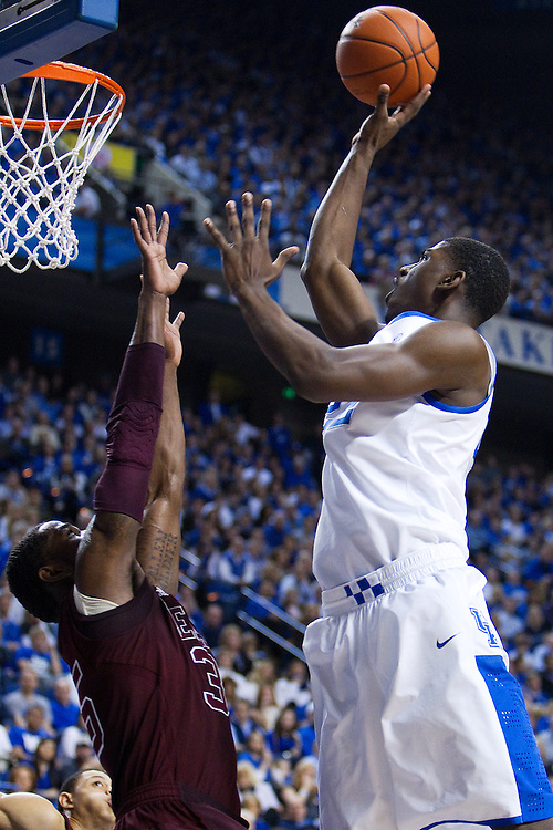 UK forward Alex Poythress, right, shoots over Texas A&M forward Ray Turner in the second half. The University of Kentucky Men's Basketball team hosted Texas A&M , Saturday, Jan. 12, 2013 at Rupp Arena in Lexington . Photo by Jonathan Palmer/Special to the Courier-Journal.