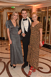 Left to right, Sophie Bashad, Basil Fisher and Belle Hutley at The Cartier Racing Awards 2018 held at The Dorchester, Park Lane, England. 13 November 2018. <br /> <br /> ***For fees please contact us prior to publication***